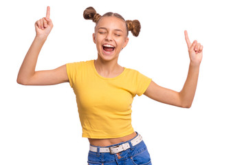 Portrait of funny teen girl enjoying music and dances, isolated on white background. Beautiful caucasian young teenager having fun. Happy cute child in yellow.