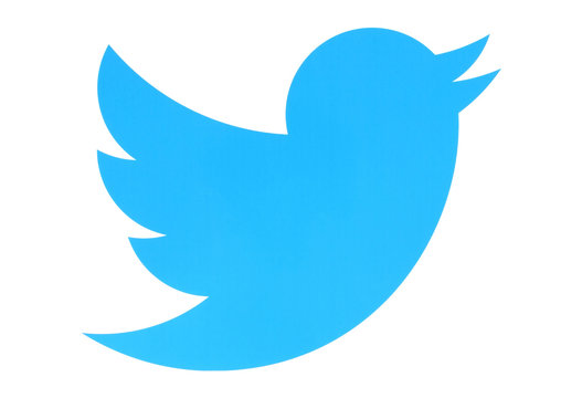 KIEV, UKRAINE - MAY 26, 2015:Twitter logotype bird printed on paper. Twitter is an online social networking service that enables users to send and read short messages