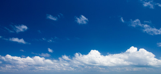 Blue sky background with tiny clouds. clouds in the blue sky