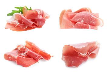 Fototapeta Set of delicious sliced jamon on white background obraz