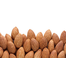 border of whole almond nuts isolated on white background