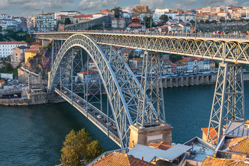 Side view of the metalwork of the famous Luis I Bridge in the Portuguese city of Porto against the...