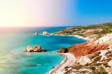 Seashore and pebble beach with wild coastline in Cyprus island, Greece by Petra tou Romiou landmark