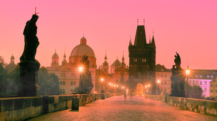 Poster Praag Charles Bridge in the morning, silhouette of Bridge Tower and saint sculptures with street lights in Prague, Czech Republic