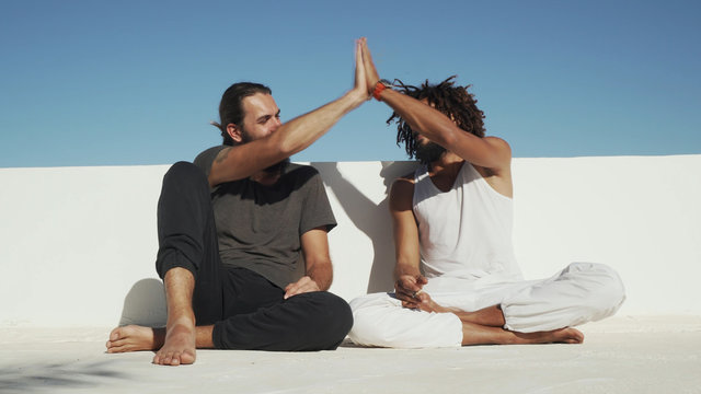 Multicultural friends smoke weed and high five each other rooftop shaky footage