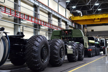 Inside of the Wheel Tractor Plant . Industrial workshop for the production of military trucks. Factory of the manufacturing wheel chassis and vehicles which carries heavy loads