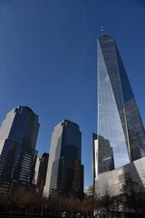 Foto auf Leinwand An der Decke Manhattan (financial district) skyscrapers, New York, view on a sunny, blue day.