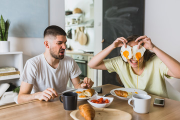 romantic couple eating breakfast at home