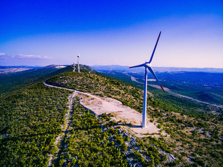 Aerial view of windmills in summer landscape in Croatia. Wind turbines for electric power