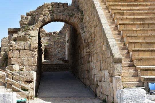 The ruins at the entrance of the ancient Roman amphitheater in the ancient city of Caesarea, Israel. Caesarea was a Roman city named after the Caesar and built by King Herod the Great.
