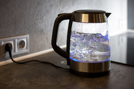 Electric kettle boils in the kitchen
