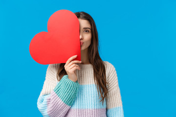 Romantic gesture, love and valentines day concept. Dreamy attractive girlfriend in winter sweater,...