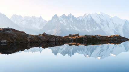 Panorama of Chesery lake (Lac De Cheserys) and snowy Monte Bianco mountains range on background,...