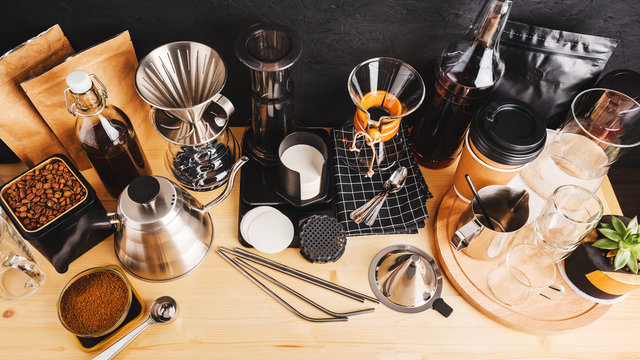 Accessories and utensils for making coffee using alternative methods, wooden table in the interior of the coffee shop