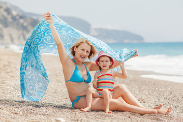 Mother and daughter enjoys at the beach