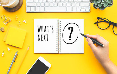 Business inspiration concepts with woman writing What's next? text on papernote
