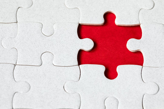 Jigsaw puzzle with missing piece. Missing puzzle pieces. Concept image of unfinished task. Completing final task, missing jigsaw puzzle pieces and business concept with a puzzle piece missing.
