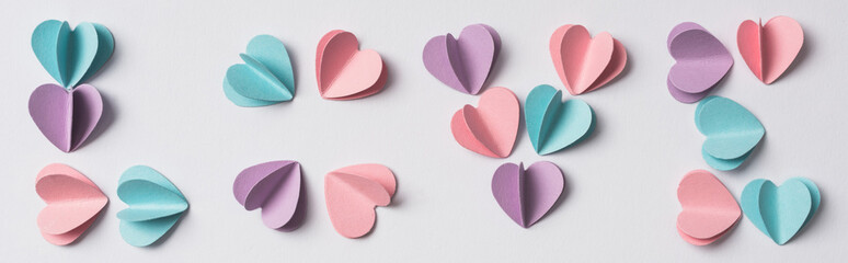 top view of love lettering made of colorful paper hearts on white background, panoramic shot Fotobehang