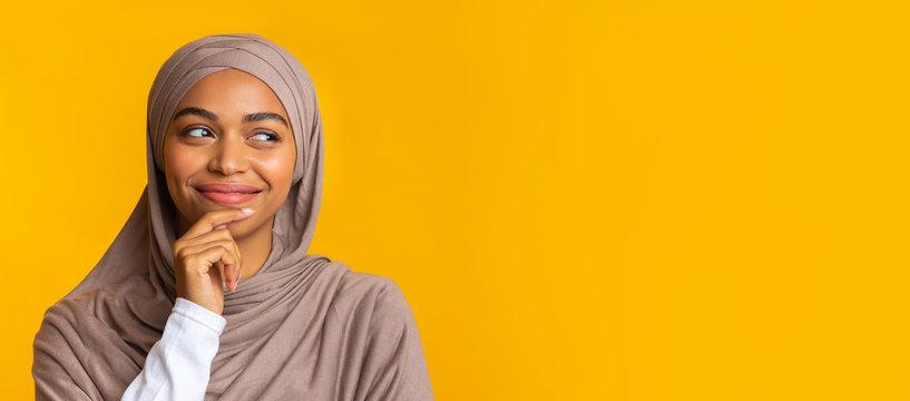 Portrait Of Pensive Black Muslim Girl Looking Aside At Copy Space