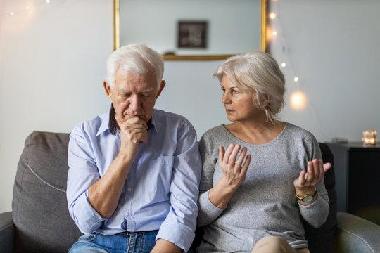 Senior couple having an argument at home