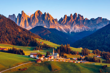 Santa Maddalena (Santa Magdalena) village with magical Dolomites mountains in autumn, Val di Funes valley, Trentino Alto Adige region, South Tyrol, Italy, Europe. Santa Maddalena Village, Italy.