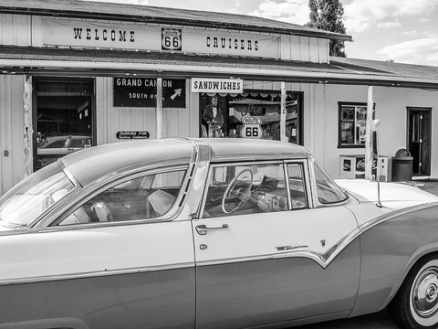 Williams, Arizona, United States - June 14, 2007: Classic car parked near a typical gift shop in town on the road sixty-six. Balck and white.