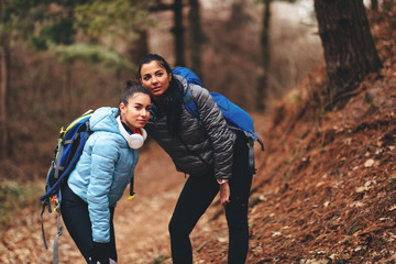 Two young women hikers during a cold day in the woods