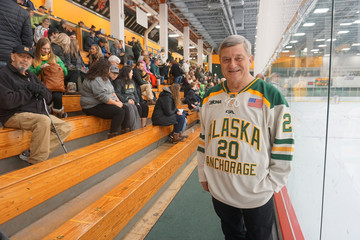 U.S. Census Bureau director Steven Dillingham poses at the hockey game in Anchorage