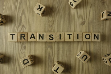 Word transition from wooden blocks on desk