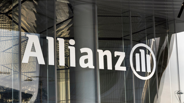 Logo sign of the Allianz insurance company at the entrance of the headquarters building, Milan, Italy - January 19, 2020