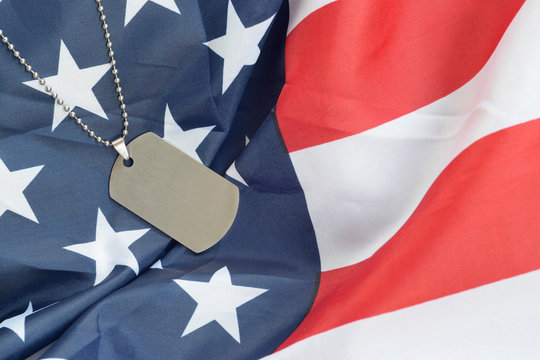 Silvery military beads with dog tag on United States fabric flag