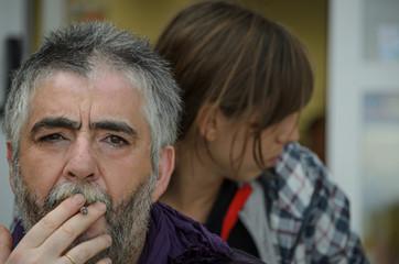 Father smoking daughter looks away