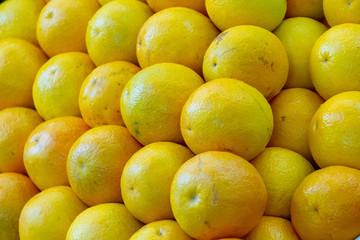 Fototapeta Macro photo citrus fruit lemons. Stock photo yellow lemon fruits