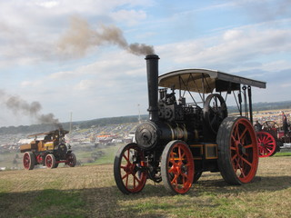 two historical steam engines  at a hill at the dorset steam fair in england Fototapete