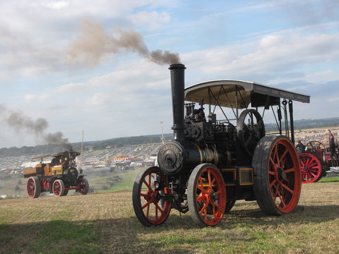 two historical steam engines  at a hill at the dorset steam fair in england