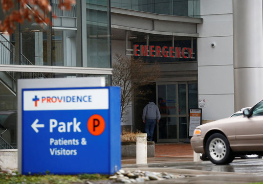 A man walks into the emergency room entrance at Providence Regional Medical Center after coronavirus victim treated in Everett
