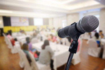 Microphone over the blurred business forum Meeting or Conference Room Concept, Blurred background.