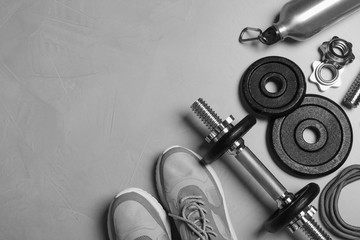 Gym equipment on light grey background, flat lay