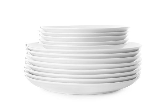 Stack of clean plates isolated on white