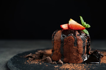 Delicious warm chocolate lava cake on slate board, closeup. Space for text Fototapete