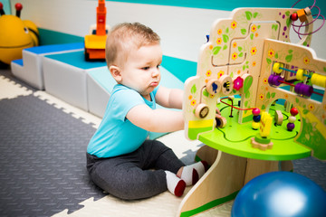 Baby Playing with Wooden Puzzle