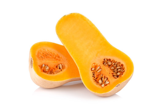 half butternut squash with seeds isolated on white background.