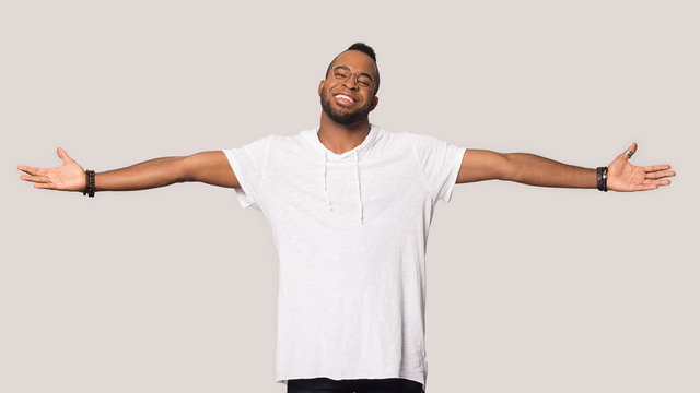 Smiling black man stretch hands show big sales