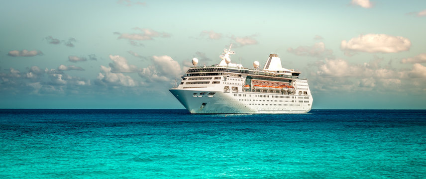 Cruise ship sailing on the Caribbean Sea. Side view of the vessel. Wide image.