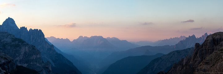 Looking South-East from the Three Peaks in the Dolomite Alps during sunrise, South Tyrol, Italy