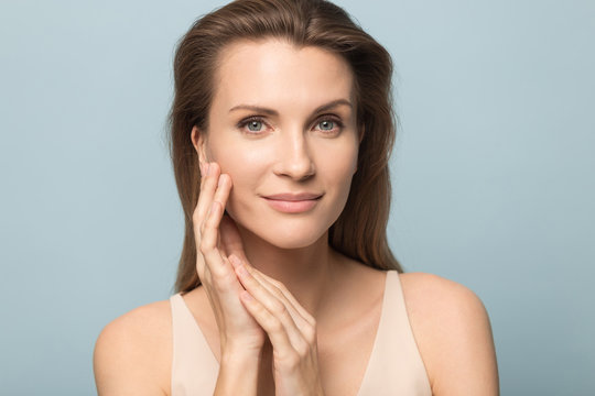 Portrait of beautiful woman touch healthy clean skin