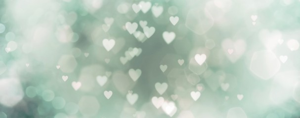 abstract background with bokeh and green hearts