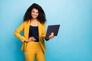 Photo of pretty assistant dark skin wavy lady holding notebook search information internet help boss friendly worker wear specs yellow suit blazer pants isolated blue color background