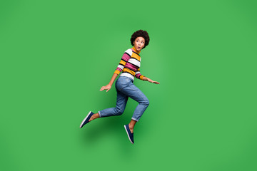 Fototapete - Full size profile side photo of negative panic afro american hipster girl look copy space monster jump run wear fall denim jeans bright isolated over green color background