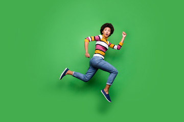 Fototapete - Full body photo of frustrated afro american girl loo copyspace see horrible monster jump run wear denim jeans beautiful hipster clothing isolated over green color background